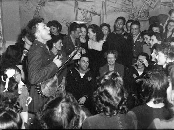 1944, Seeger opening the Washington labor canteen. Yes, that's Eleanor Roosevelt seated among the sailors.