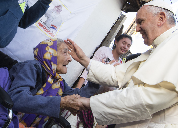 Pope Francis greets an elderly woman as he meets with people of Banado Norte, a poor neighborhood in Asuncion, Paraguay, July 12 (CNS photo/Paul Haring).