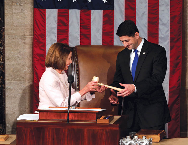 U.S. House Speaker Paul Ryan receives the gavel from House Democratic leader Nancy Pelosi on Jan. 3. (Jonathan Ernst/Reuters)