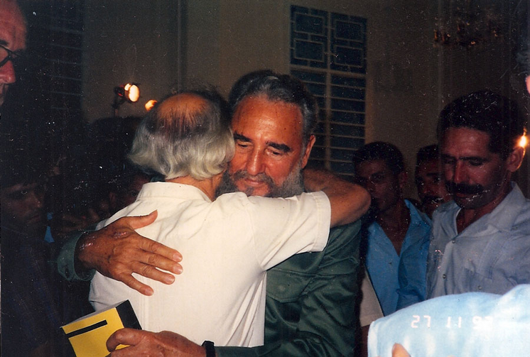 Fidel Castro embracing Paul Mayer with a Bible in his hand. Photos courtesy of wrestlingwithangelsbook.com.