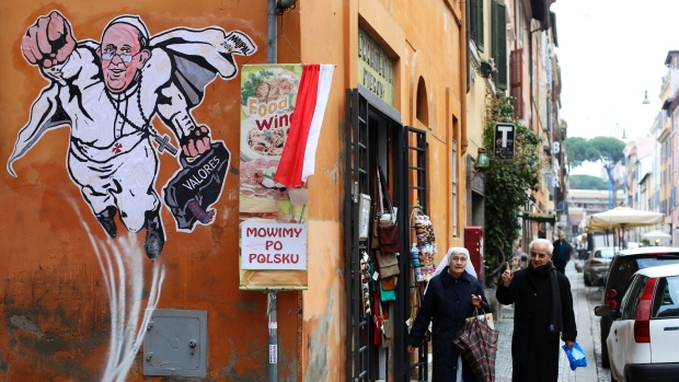 """Superpope"" graffiti has sprouted up on buildings around Vatican City. (Alessandro Bianchi/Reuters)"
