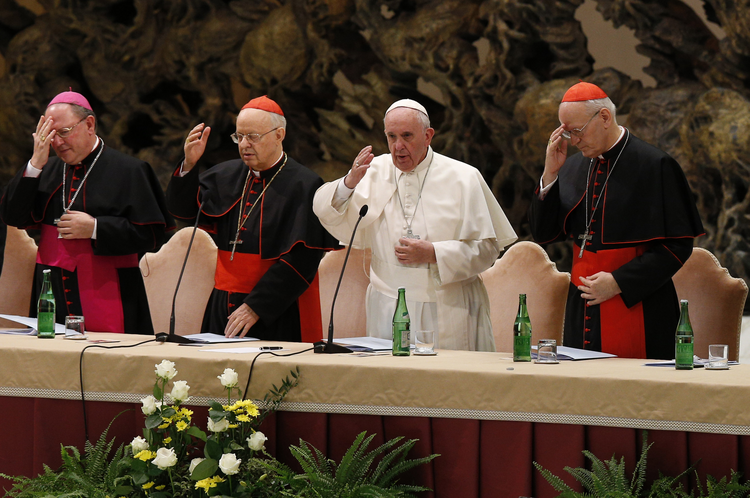 Pope Francis delivers his blessing during an event marking the 50th anniversary of the Synod of Bishops in Paul VI hall at the Vatican, Oct. 17 (CNS Photo / Paul Haring).