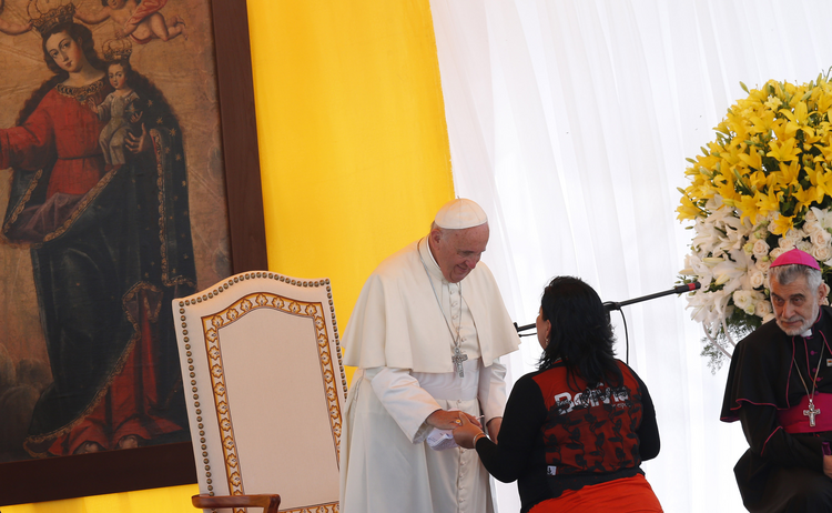 Pope Francis greets a woman during a ceremony in Palmasola prison in Santa Cruz, Bolivia, July 10 (CNS photo/Paul Haring).
