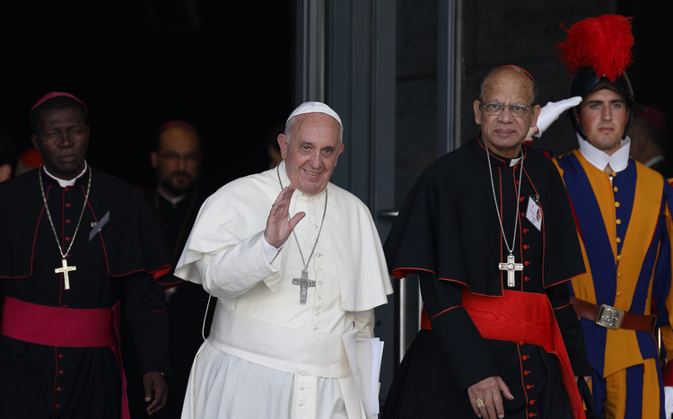 Pope Francis walks next to Indian Cardinal Oswald Gracias as he leaves the morning session of the extraordinary Synod of Bishops on the family at the Vatican, Oct. 9, 2014 (CNS photo/Paul Haring).