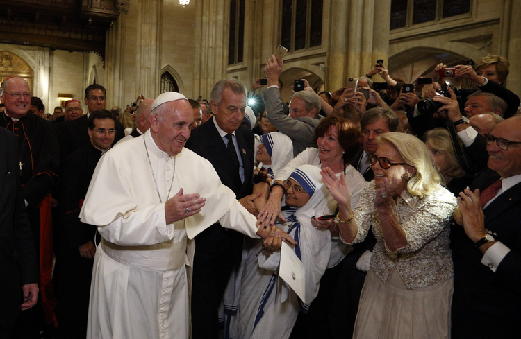 Pope Francis greets people as he arrives to celebrate vespers with priests, men and women religious in St. Patrick's Cathedral in New York Sept. 24. (CNS photo/Paul Haring)