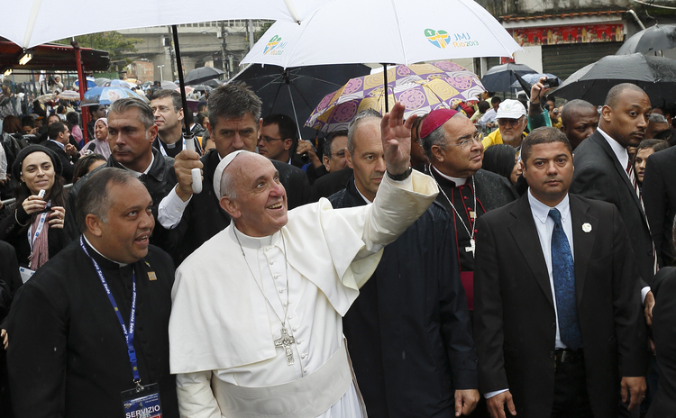 Pope Francis waves to residents in Varginha slum in Rio de Janeiro, July 25 (CNS/Paul Haring)