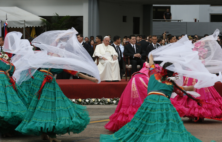 Dancers perform as Pope Francis arrives at Silvio Pettirossi International Airport in Asuncion, Paraguay, July 10 (CNS photo/Paul Haring).