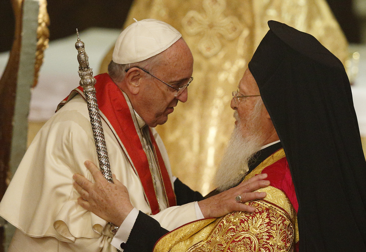 Pope Francis and Ecumenical Patriarch Bartholomew of Constantinople embrace during a prayer service in the patriarchal Church of St. George in Istanbul Nov. 29. (CNS photo/Paul Haring)