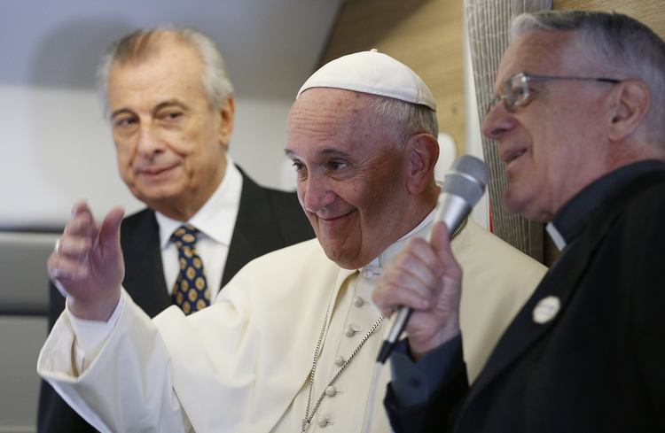 Pope Francis greets journalists aboard his flight from Rome to Havana, Sept. 19 (CNS photo/Paul Haring).
