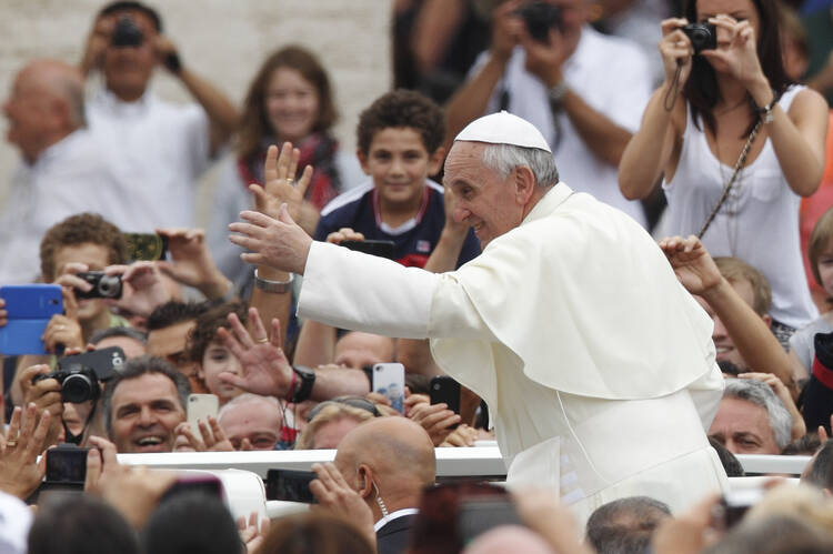 Pope greets crowd after celebrating Mass for catechists in St. Peter's Square, Sept. 29. (Paul Haring. CNS).