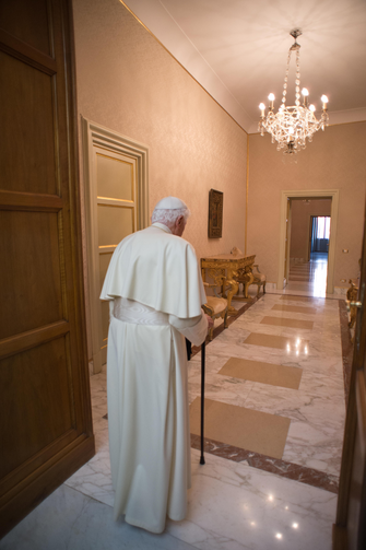 Pope Benedict XVI retires to the apartment at his summer residence in Castel Gandolfo, Italy, Feb. 28, after appearing for the last time at the balcony of the residence.