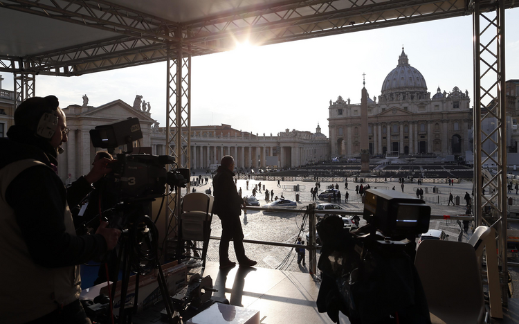 Technician works on a structure set up for TV media in St. Peter's Square at Vatican -- CNS photo/Alessandro Bianchi, Reuters