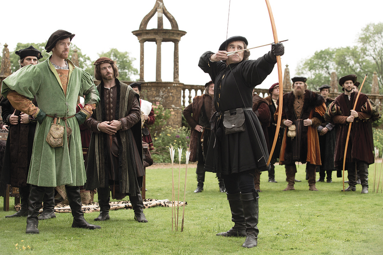 "AIMING HIGH. Mark Rylance, with bow, as Thomas Cromwell in ""Wolf Hall"""