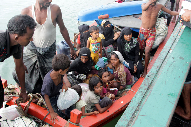 Refugees from Myanmar and Bangladesh are seen in their boat before their rescue by fisherman in Julok, Indonesia, May 20. (CNS photo/Stringer, EPA)