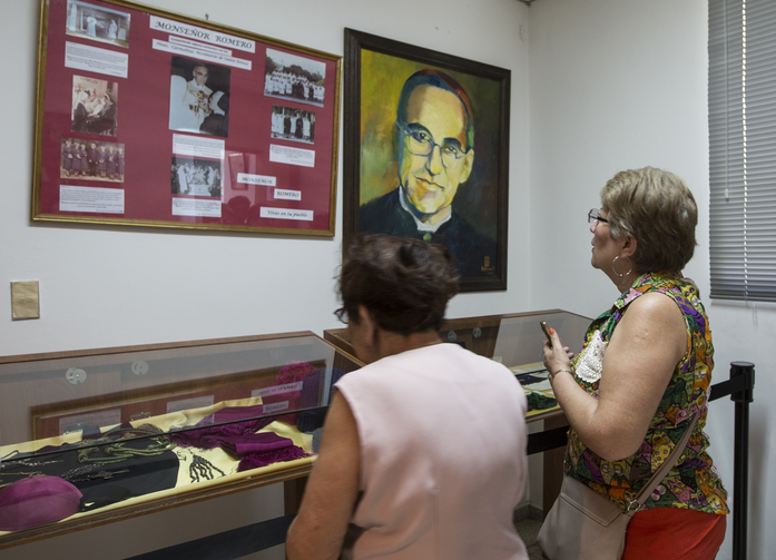 Women look at relics and other items of Salvadoran Archbishop Oscar Romero March 22 at a museum dedicated to the late archbishop at Divine Providence Hospital in San Salvador. (CNS photo/Octavio Duran)
