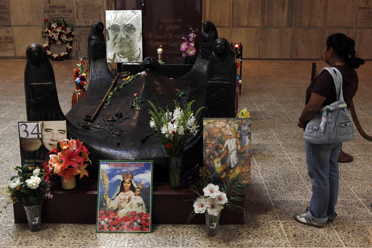 A tourist visits the tomb of Archbishop Oscar Romero in San Salvador.