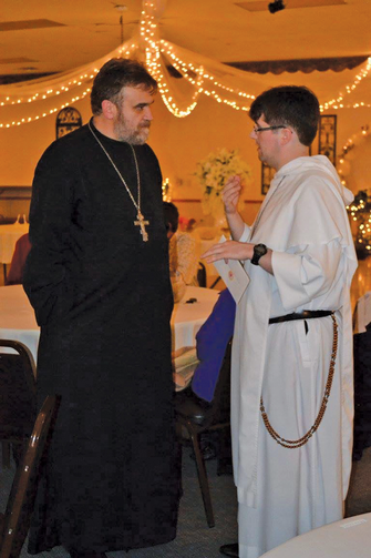 The Rev. Miron Kerul-Kmec and the author at St. Nicholas Byzantine Catholic Church in Barberton, Ohio.