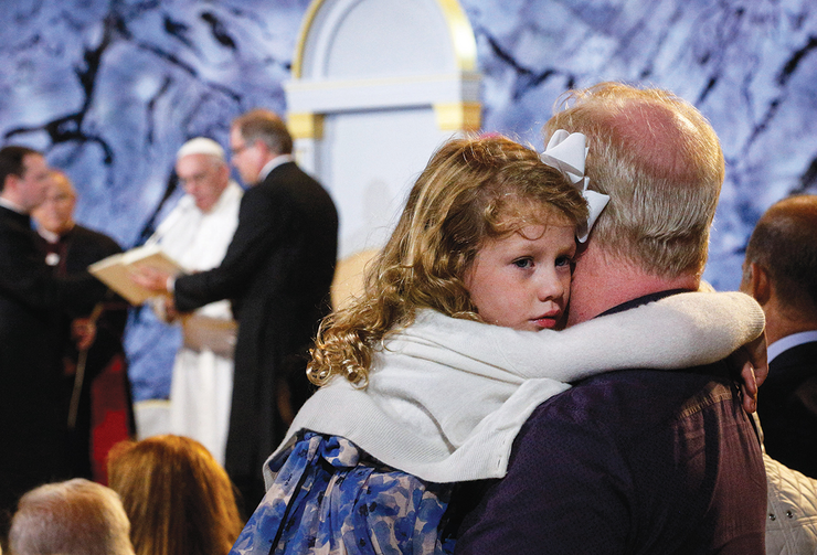 LOVE IN ACTION. A father holds his daughter at the Festival of Families with Pope Francis in Philadelphia on Sept. 26.