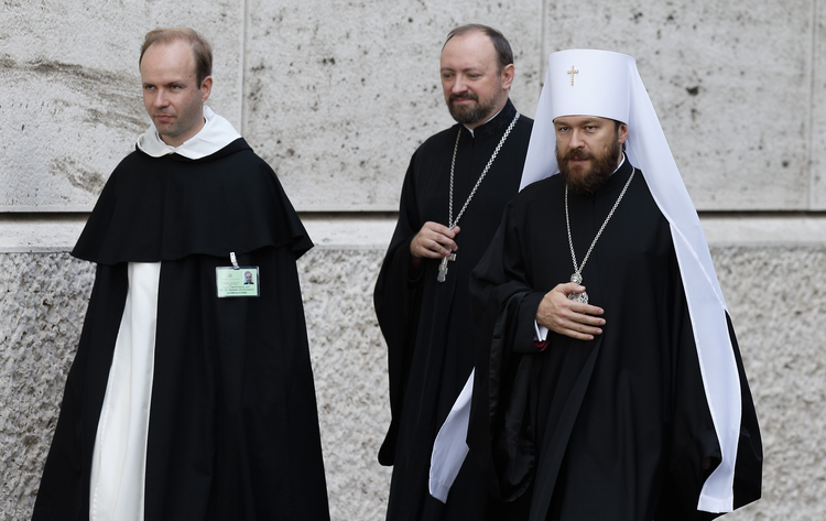 Metropolitan Hilarion of Volokolamsk, head of ecumenical relations for the Russian Orthodox Church, right, arrives for the morning session of the extraordinary Synod of Bishops on the family at the Vatican Oct. 16. (CNS photo/Paul Haring)