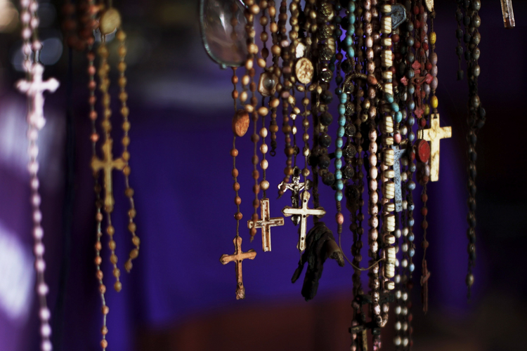 Rosaries hang among the personal possessions of genocide victims at a memorial inside the church in Ntarama, Rwanda. Some 5,000 people, mostly women and children, sought refuge near the church in April 1994, but were massacred by Hutu extremists.