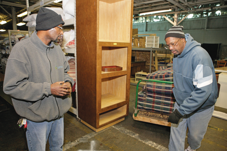 SUCCESS STORY. Michael Gordon, left, has become a manager for a furniture bank run by Caritas, an agency providing services to homeless people in Richmond, Va. (CNS photo/Jay Paul)