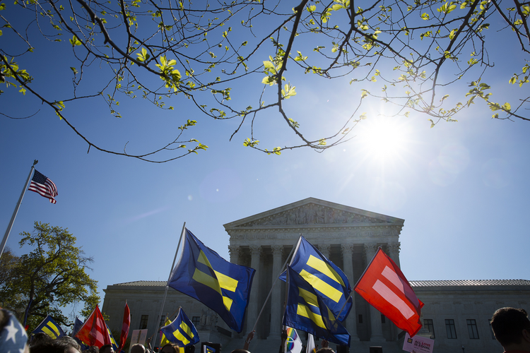Supporters for same-sex marriage stand outside the U.S. Supreme Court in Washington in April. (CNS photo/Tyler Orsburn)