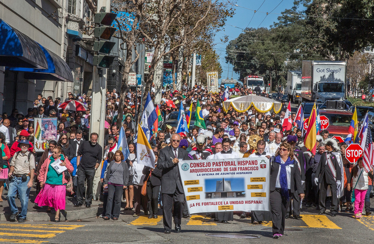 Large crowd processes through streets of San Francisco during annual rosary rally, Oct. 11, 2014.