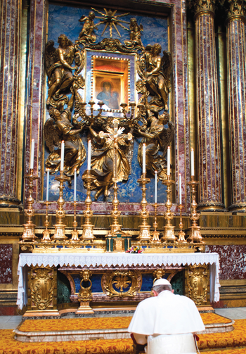 THE POPE AT PRAYER. Pope Francis prays before an icon of Mary, Salvation of the Roman People, in a chapel of the Basilica of St. Mary Major in Rome the morning after his election.
