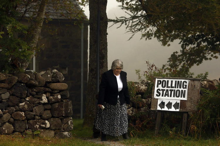 voter leaves a polling station in Portree, Scotland, Sept. 18. (CNS photo/Cathal McNaughton, Reuters)