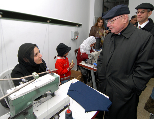 Bishop William S. Skylstad of Spokane, Wash., visits a women's sewing factory in the Dehiyshe refugee camp near Bethlehem in the West Bank on Jan. 12, 2007. (CNS photo/Debbie Hill)