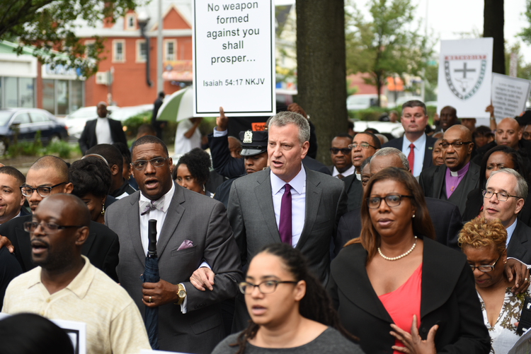 New York City Mayor Bill de Blasio joined congregants of the Greater Allen A.M.E. Church to march in solidarity with Emanuel A.M.E. in Charleston, S.C., where a gunman killed nine people gathered for Bible study on June 17.