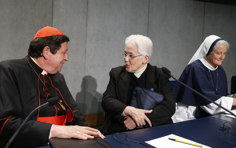 Cardinal Braz de Aviz speaks with Sister Holland at conclusion of Vatican press conference for release of final report of Vatican-ordered investigation of U.S. communities of women religious, Dec. 16 (Paul Haring, CNS photo).