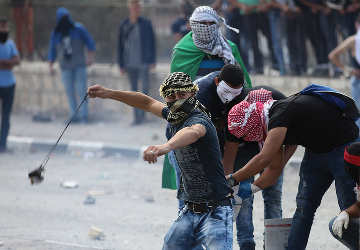 TENSIONS MOUNT. Palestinian protesters clash with Israeli soldiers in Bethlehem, West Bank, on Oct. 6.