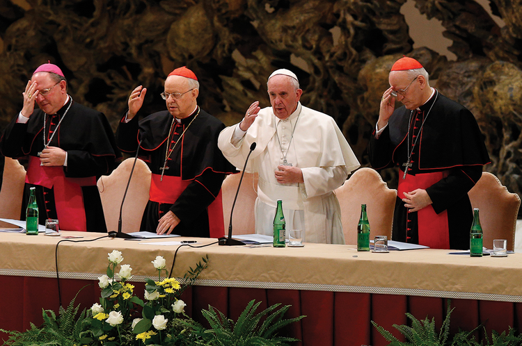 "SYNODAL BLESSING. Pope Francis begins an event marking the 50th anniversary of the Synod of Bishops in Paul VI Hall at the Vatican on Oct. 17. The pope outlined his vision for a ""listening church."""
