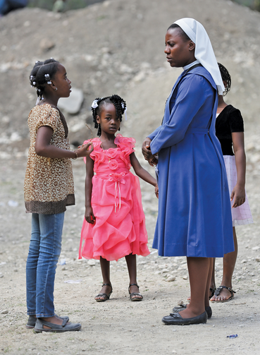 HELP AND HOPE. Sister Augusta Ernest, principal at St. Martin de Porres School in Hinche, Haiti.
