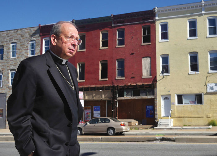HOPE BUILDING. Archbishop William Lori tours West Baltimore the morning after civil unrest brought national attention to conditions in the city's Sandtown neighborhood.