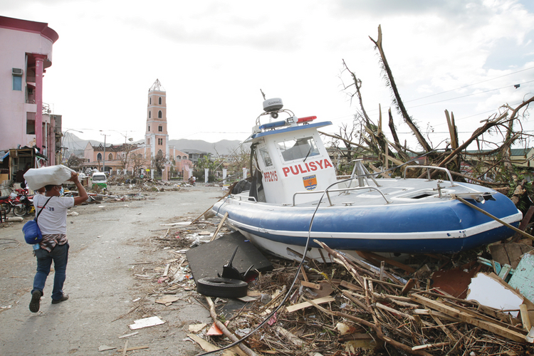 AFTERMATH: A police boat washed into Tacloban City by Typhoon Haiyan