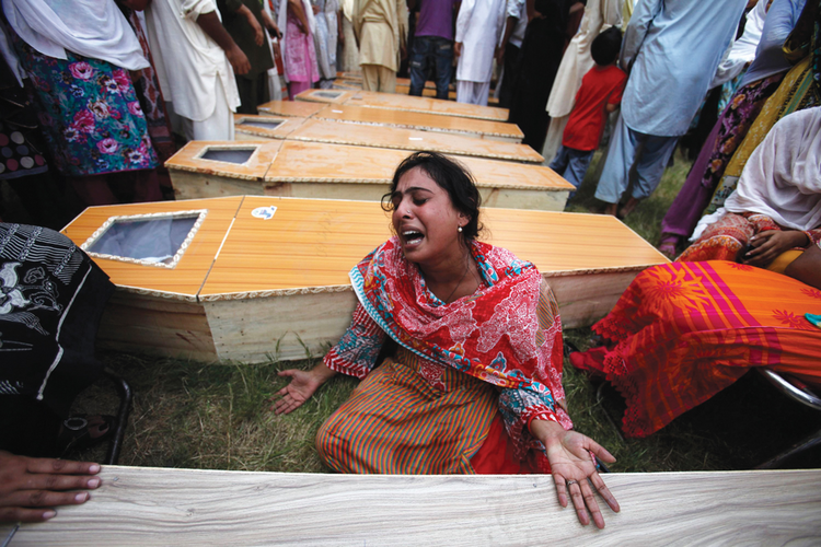 Mourning in Pakistan: A Christian woman mourns her brother, killed along with 80 others in an attack at All Saints Church in Peshawar, Pakistan, in 2013.