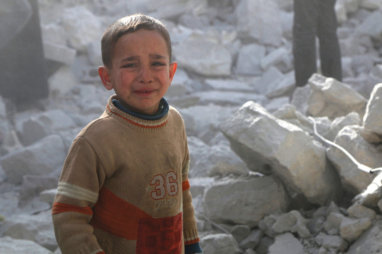 WAR CRIME. A boy of Aleppo weeps amid the rubble of a building bombed by Syrian government forces on March 6.