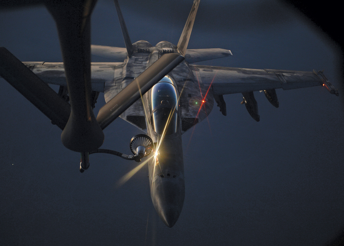 AIR BORNE. A U.S. fighter jet refueling over northern Iraq on Aug. 21.