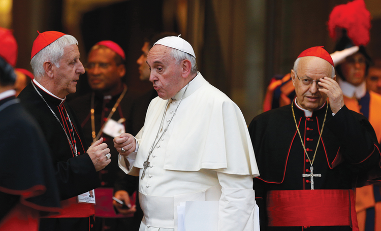 FINAL WORDS. Pope Francis talks with Italian Cardinal Giuseppe Versaldi as they leave the synod's concluding session on Oct. 18. At right is Italian Cardinal Lorenzo Baldisseri, general secretary of the Synod of Bishops.