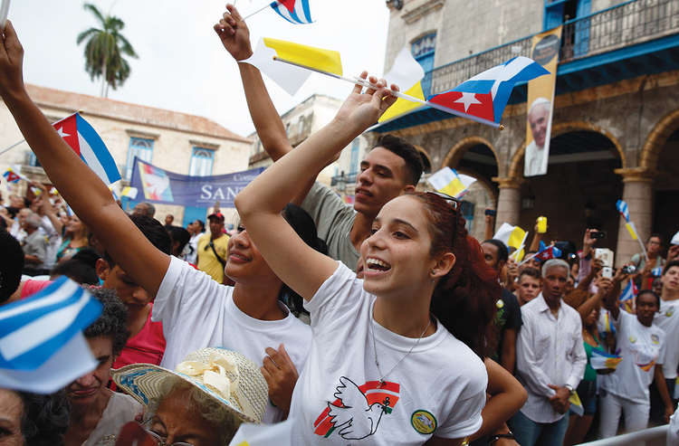 "THE POPE'S CUBAN ""DREAMERS."" Young people cheer as Pope Francis arrives at the cathedral in Havana, Sept. 20."