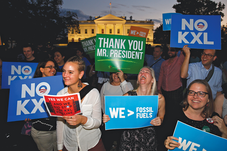 Thanks, Obama! Activists celebrate outside the White House after the Obama administration's rejection of the Keystone XL pipeline on Nov. 6.