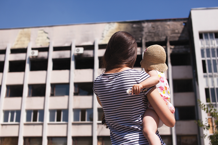CITY IN RUINS. Reviewing Mariupol's burned out city hall.