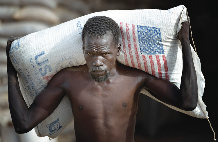 Farmed in the U.S.A: Grain arrives in South Sudan. International food assistance is just one component of the complex farm bill.