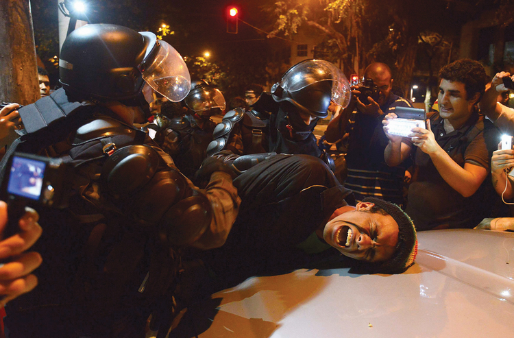 Soccer Wars: Riot police tangle with Brazilians protesting excessive spending on the 2014 FIFA World cup in July 2013.