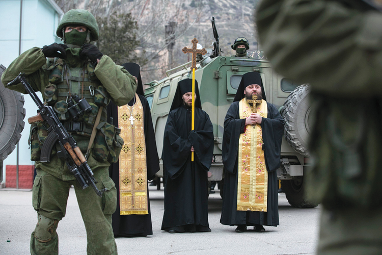 Call to Arms? Orthodox clergymen pray outside a border guard post in Ukraine's Crimean region on March 1.