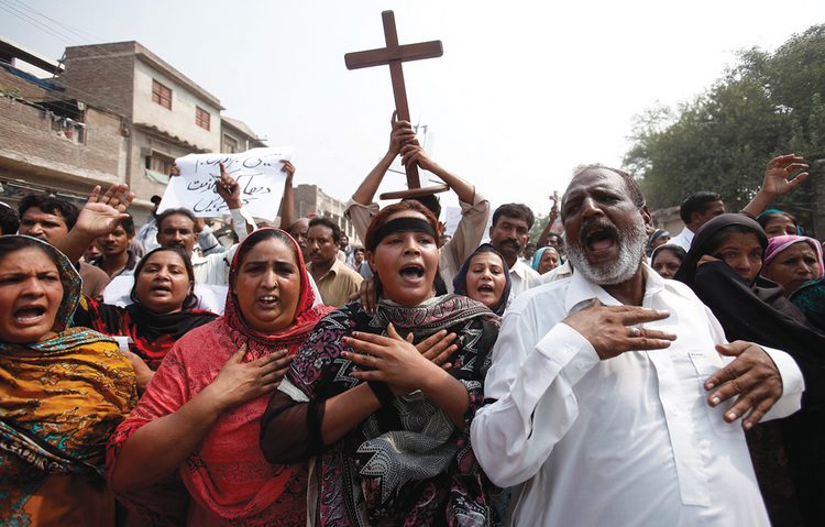 PERSECUTED COMMUNITY. Pakistani Christians at a protest rally in 2013 to condemn a suicide attack on All Saints Church in Peshawar.
