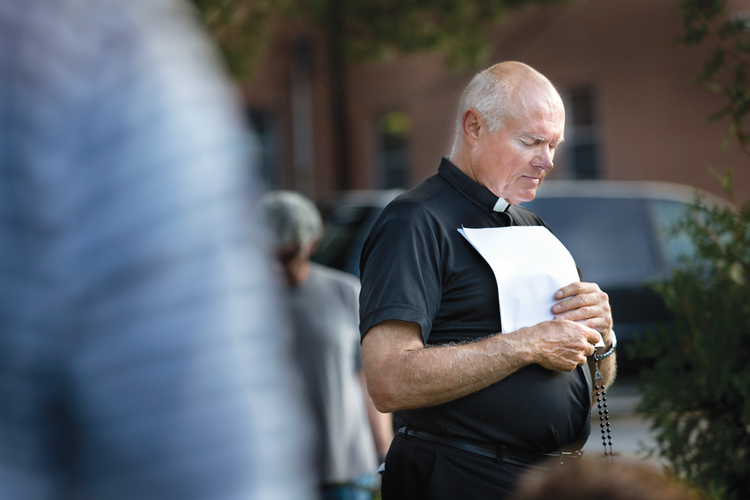 PEACEMAKING. Father Robert Rosebrough of Blessed Teresa of Calcutta Parish in Ferguson, Mo., leads a prayer vigil for peace on Aug. 11.