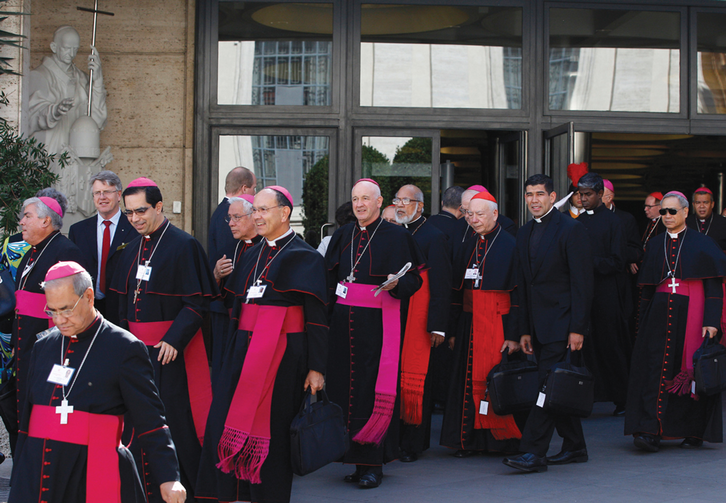 SYNODAL STROLL. Cardinals and bishops leave the Oct. 9 morning session at the Vatican.